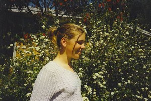 nikki in front of flowers